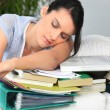 Student asleep next to work — Stockfoto