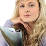 Blond woman reading magazine — Stock Photo #8340249
