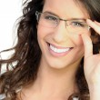 Happy woman touching glasses — Stock Photo #8340267