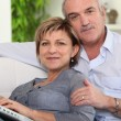 Couple using a laptop at home — Stock Photo