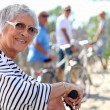65 years old woman doing bike in the country with friends — Stock Photo