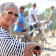 65 years old womdoing bike in country with friends — Stock Photo #8340606