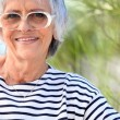 Elderly lady at the beach — Stock Photo #8340629