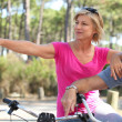 Senior couple riding bikes in the park — Stock Photo