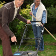 Senior couple gardening. - Stock Photo