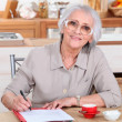 Stock Photo: Grandmother writing
