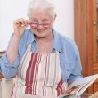 Grandmother cooking in the kitchen — Stock Photo