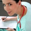 Female doctor with clipboard — Stock Photo