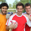 Three footballers in front of goal — Stock Photo #8341634