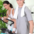 Couple working-out at the gym — Stock Photo #8342418
