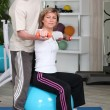 Mature woman working out with coach — Stock Photo #8343012