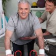 Stock Photo: Grey haired mwith personal trainer