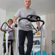 Couple working out on treadmill and cycle machine — Stock Photo #8343128