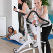 Stock Photo: Women using stepper machine