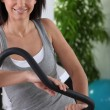 Stock Photo: Smiling womusing sports apparatus