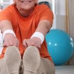 Elderly woman doing exercise — Stock Photo