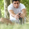 Man stretching in the forest — Stock Photo #8343412