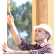 Stock Photo: Woodworker on construction site