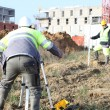 Stock Photo: Surveyors working on construction site