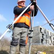 Stock Photo: A land surveyor using an altometer