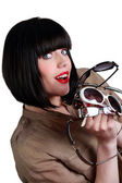 Woman with many pairs of sunglasses — Stock Photo