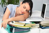 Student asleep next to work — Stock Photo
