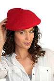 Attractive woman in a beret — Stock Photo