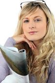 Blond woman reading magazine — Stock Photo