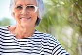 Elderly lady at the beach — Stock Photo