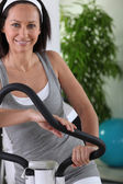 Smiling woman using sports apparatus — Stock Photo