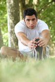 Man stretching in the forest — Stock Photo