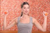 A brunette exercising. — Stock Photo