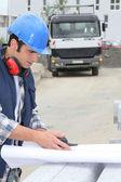 Builder unrolling plan — Stock Photo