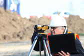 Construction site surveyor — Stock Photo