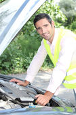 Man looking under car bonnet — Stock Photo