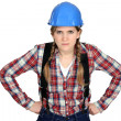 Craftswoman looking angry - Stock Photo
