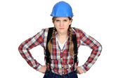 Craftswoman looking angry — Stock Photo