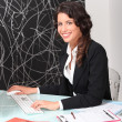 Stock Photo: Female estate agent working at desk