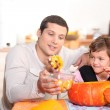 A father and his daughter at Halloween time — Stock Photo