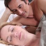 Man watching woman sleeping — Stock Photo