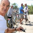 A senior man doing bike with friends in summer — Stock Photo #8383023
