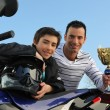 Boy winning a motorcycle racing cup — Stock Photo