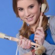 Young woman holding a paint can and paintbrushes — Stock Photo #8384255