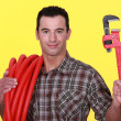 Workman on yellow background — Stock Photo