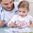 Little girl drawing with father — Stock Photo #8384989