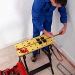 Electrician fixing breaker box — Stock Photo #8385083
