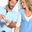 Couple cooking together - Stockfoto