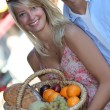 Couple buying fruit - Stock Photo
