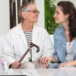 Stock Photo: Young womhelping senior lady at home