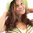 Girl with curly hair in a summer hat — Stock Photo #8385594